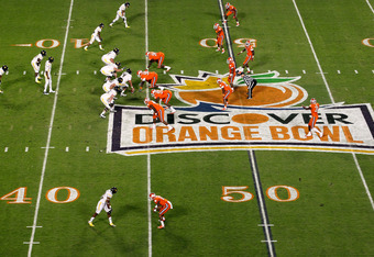 MIAMI GARDENS, FL - JANUARY 04:  Geno Smith #12 of the West Virginia Mountaineers leads his team on offense in the shotgun psread formation against the Clemson Tigers during the Discover Orange Bowl at Sun Life Stadium on January 4, 2012 in Miami Gardens,