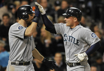 CHICAGO, IL - JUNE 01:  Kyle Seager #15 of the Seattle Mariners (R) IS congratulated by Dustin Ackley #13 after hitting a two-run home run against the Chicago White Sox in the seventh inning on June 1, 2012 at U.S. Cellular Field in Chicago, Illinois.  (P