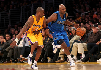 LOS ANGELES, CA - JANUARY 16: Lamar Odom #7 of the Dallas Mavericks drives down the court against Kobe Bryant #24 of the Los Angeles Lakers at Staples Center on January 16, 2012 in Los Angeles, California. The Lakers won 73-70.  NOTE TO USER: User express