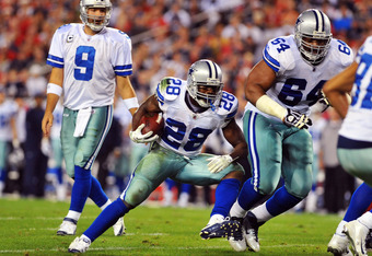 TAMPA, FL - DECEMBER 17:  Running back Felix Jones #28 of the Dallas Cowboys runs for a gain against the Tampa Bay Buccaneers December 17, 2011 at Raymond James Stadium in Tampa, Florida. (Photo by Al Messerschmidt/Getty Images)