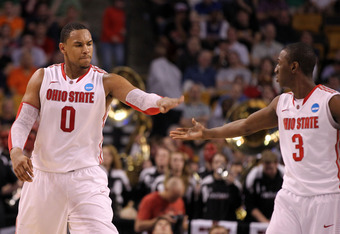 BOSTON, MA - MARCH 22:  Jared Sullinger #0 and Shannon Scott #3 of the Ohio State Buckeyes reacts after a play against the Cincinnati Bearcats during their 2012 NCAA Men's Basketball East Regional Semifinal game at TD Garden on March 22, 2012 in Boston, M