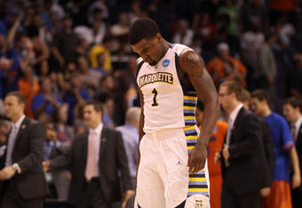 PHOENIX, AZ - MARCH 22:  Darius Johnson-Odom #1 of the Marquette Golden Eagles walks off the court after losing to the Florida Gators 68-58 during the 2012 NCAA Men's Basketball West Regional Semifinal game at US Airways Center on March 22, 2012 in Phoeni