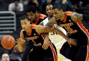 LOS ANGELES, CA - MARCH 08:  Jared Cunningham #1 of the Oregon State Beavers moves the ball up court alongside teammate Eric Moreland #15 in the first half against the Washington Huskies during the quarterfinals of the 2012 Pacific Life Pac-12 basketball