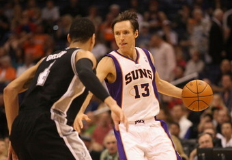 PHOENIX, AZ - MARCH 27:  Steve Nash #13 of the Phoenix Suns handles the ball against the San Antonio Spurs during the NBA game at US Airways Center on March 27, 2012 in Phoenix, Arizona. The Spurs defeated the Suns 107-100. NOTE TO USER: User expressly ac