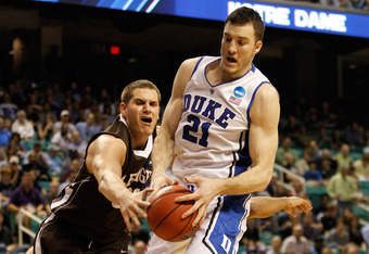 GREENSBORO, NC - MARCH 16:  Miles Plumlee #21 of the Duke Blue Devils grabs the ball as Justin Maneri #31 of the Lehigh Mountain Hawks attempts to grab it in the first half during the second round of the 2012 NCAA Men's Basketball Tournament at Greensboro