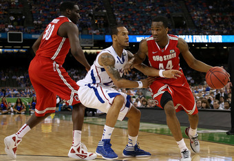 NEW ORLEANS, LA - MARCH 31:  William Buford #44 of the Ohio State Buckeyes drives on Travis Releford #24 of the Kansas Jayhawks in the second half during the National Semifinal game of the 2012 NCAA Division I Men's Basketball Championship at the Mercedes