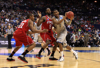 COLUMBUS, OH - MARCH 18: Hollis Thompson #1 of the Georgetown Hoyas handles the ball against C.J. Leslie #5 and C.J. Williams #21 of the North Carolina State Wolfpack in the first half during the third round of the 2012 NCAA Men's basketball tournament at