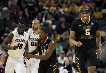 PITTSBURGH, PA - MARCH 15:  Kevin Jones #5 of the West Virginia Mountaineers celebrates after a play against the Gonzaga Bulldogs during the second round of the 2012 NCAA Men's Basketball Tournament at Consol Energy Center on March 15, 2012 in Pittsburgh,