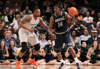 NEW YORK, NY - MARCH 08:  Yancy Gates #34 of the Cincinnati Bearcats in action against Henry Sims #14 of the Georgetown Hoyas during their quarterfinal game of the 2012 Big East Men's Basketball Tournament at Madison Square Garden on March 8, 2012 in New