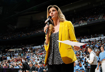 ATLANTA, GA - MARCH 11:  ESPN sideline report Erin Andrews conducts on on camera report against the Florida State Seminoles during the Final Game of the 2012 ACC Men's Basketball Conference Tournament at Philips Arena on March 11, 2012 in Atlanta, Georgia