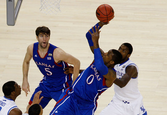 NEW ORLEANS, LA - APRIL 02:  Thomas Robinson #0 of the Kansas Jayhawks shoots over Terrence Jones #3 of the Kentucky Wildcats in the first half in the National Championship Game of the 2012 NCAA Division I Men's Basketball Tournament at the Mercedes-Benz