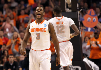 BOSTON, MA - MARCH 24:  Dion Waiters #3 of the Syracuse Orange reacts after a basket against the Ohio State Buckeyes during the 2012 NCAA Men's Basketball East Regional Final at TD Garden on March 24, 2012 in Boston, Massachusetts.  (Photo by Jim Rogash/G