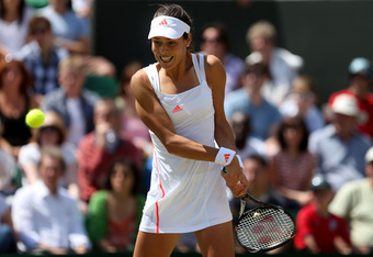 LONDON, ENGLAND - JUNE 30:  Ana Ivanovic of Serbia returns a shot during her Ladies' Singles third round match against Julia Goerges of Germany on day six of the Wimbledon Lawn Tennis Championships at the All England Lawn Tennis and Croquet Club at Wimble