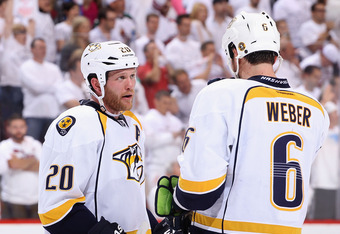GLENDALE, AZ - MAY 07:  (L-R) Ryan Suter #20 and Shea Weber #6 of the Nashville Predators talk in Game Five of the Western Conference Semifinals against the Phoenix Coyotes during the 2012 NHL Stanley Cup Playoffs at Jobing.com Arena on May 7, 2012 in Gle