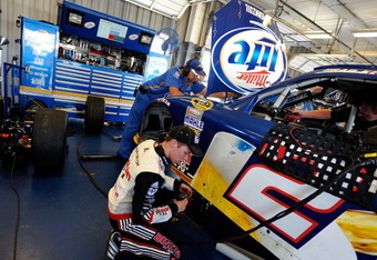 SPARTA, KY - JUNE 29:  Brad Keselowski, driver of the #2 Miller Lite Dodge, works on his car in the garage during practice for the NASCAR Sprint Cup Series Quaker State 400 at Kentucky Speedway on June 29, 2012 in Sparta, Kentucky.  (Photo by Rainier Ehrh