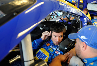 SPARTA, KY - JUNE 29:  Martin Truex Jr., driver of the #56 NAPA Auto Parts Toyota, talks to his crew chief Chad Johnston in the garage area during practice for the NASCAR Sprint Cup Series Quaker State 400 at Kentucky Speedway on June 29, 2012 in Sparta,