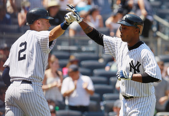NEW YORK, NY - JUNE 30:  Dewayne Wise #45 of the New York Yankees is greeted by Derek Jeter #2 after hitting a fifth-inning home run against the Chicago White Sox at Yankee Stadium on June 30, 2012 in the Bronx borough of New York City. Yankees defeated W