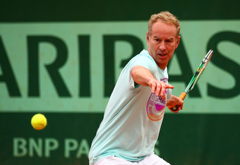PARIS, FRANCE - JUNE 06:  John McEnroe of USA plays a forehand during a practice session ahead of his men's Legends doubles match against during day 11 of the French Open at Roland Garros on June 6, 2012 in Paris, France.  (Photo by Getty Images/Getty Ima
