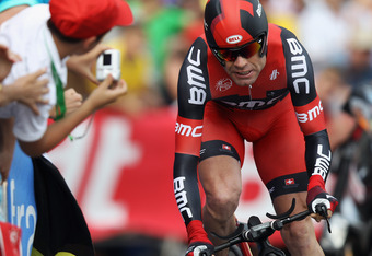 LIEGE, BELGIUM - JUNE 30:  Cadel Evans of Australia and the BMC Racing Team in action during the Tour de France Prologue at Parc d'Avroy on June 30, 2012 in Liege, Belgium. The 99th Tour de France starts with 6.4km individual time trial around the streets