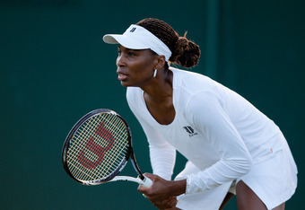 LONDON, ENGLAND - JUNE 30:  Venus Williams of the USA in action while playing with Serena Williams of the USA during their Ladies' Doubles second round match against Maria Kirilenko and Nadia Petrova of Russia on day six of the Wimbledon Lawn Tennis Champ