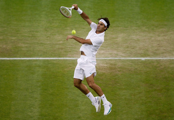 LONDON, ENGLAND - JUNE 29:  Roger Federer of Switzerland hits a forehand return during his Gentlemen's Singles third round match against Julien Benneteau of France on day five of the Wimbledon Lawn Tennis Championships at the All England Lawn Tennis and C