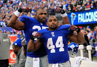 EAST RUTHERFORD, NJ - JANUARY 08:  (L-R) Brandon Jacobs #27 and Ahmad Bradshaw #44 of the New York Giants celebrates after the GIants won 24-2 against the Atlanta Falcons during their NFC Wild Card Playoff game at MetLife Stadium on January 8, 2012 in Eas
