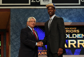 NEWARK, NJ - JUNE 28:  Harrison Barnes (R) of North Carolina greets NBA Commissioner David Stern (L) after he was selected number seven overall by the Golden State Warriors during the first round of the 2012 NBA Draft at Prudential Center on June 28, 2012