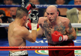 LAS VEGAS, NV - MAY 07:  (R-L) Kelly Pavlik throws a right to the face of Alfonso Lopez during the super middleweight fight at MGM Grand Garden Arena on May 7, 2011 in Las Vegas, Nevada.  (Photo by Ethan Miller/Getty Images)