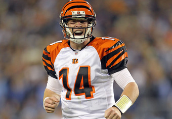 NASHVILLE, TN - NOVEMBER 06:  Andy Dalton #14 of the Cincinnati Bengals celebrates after throwing a touchdown pass during the NFL game against the Tennessee Titans at LP Field on November 6, 2011 in Nashville, Tennessee.  The Bengals won 24-17.  (Photo by