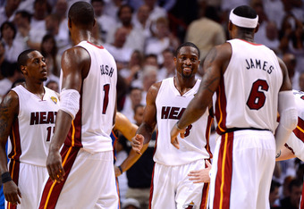 MIAMI, FL - JUNE 21:  (L-R) Mario Chalmers #15, Chris Bosh #1, Dwyane Wade #3 and LeBron James #6 of the Miami Heat celebrate during the fourth quarter against the Oklahoma City Thunder in Game Five of the 2012 NBA Finals on June 21, 2012 at American Airl