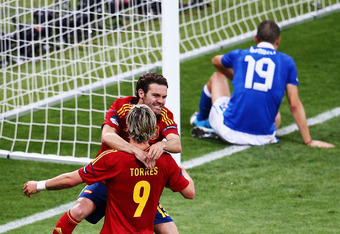 KIEV, UKRAINE - JULY 01:  Juan Mata of Spain celebrates with team-mate Fernando Torres after he scored their fourth goal during the UEFA EURO 2012 final match between Spain and Italy at the Olympic Stadium on July 1, 2012 in Kiev, Ukraine.  (Photo by Mart