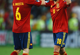 DONETSK, UKRAINE - JUNE 27: Andres Iniesta and Jordi Alba of Spain celebrate during the UEFA EURO 2012 semi final match between Portugal and Spain at Donbass Arena on June 27, 2012 in Donetsk, Ukraine.  (Photo by Laurence Griffiths/Getty Images)