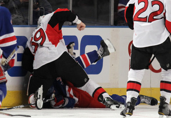 NEW YORK, NY - APRIL 14: Matt Carkner #39 of the Ottawa Senators hits Brian Boyle #22 of the New York Rangers which led to his game misconduct penalty in Game Two of the Eastern Conference Quarterfinals during the 2012 NHL Stanley Cup Playoffs at Madison