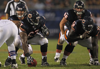 CHICAGO, IL - AUGUST 13: Nathan Enderle #10 of the Chicago Bears calls the signals as Chris Spencer #67 and Edwin Williams #70 prepare to block against the Buffalo Bills during a preseason game at Soldier Field on August 13, 2011 in Chicago, Illinois. The