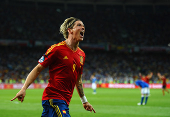 KIEV, UKRAINE - JULY 01: Fernando Torres of Spain celebrates scoring his side's third goal  during the UEFA EURO 2012 final match between Spain and Italy at the Olympic Stadium on July 1, 2012 in Kiev, Ukraine.  (Photo by Laurence Griffiths/Getty Images)