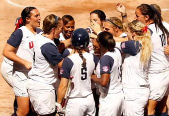 GUADALAJARA, MEXICO - OCTOBER 23:  Lauren Gibson #25 of the United States celebrates at home plate with her teammates after hitting a first inning home run against Canada during the gold medal softball game on Day Nine of the XVI Pan American Games at the