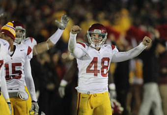 SOUTH BEND, IN - OCTOBER 22: Andre Heidari #48 of the University of Southern California Trojans celebrates a win over the Notre Dame Fighting Irish at Notre Dame Stadium on October 22, 2011 in South Bend, Indiana. USC defeated Notre Dame 31-17. (Photo by