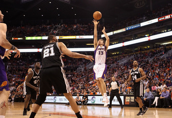 PHOENIX, AZ - MARCH 27:  Steve Nash #13 of the Phoenix Suns puts up a shot against the San Antonio Spurs during the NBA game at US Airways Center on March 27, 2012 in Phoenix, Arizona. The Spurs defeated the Suns 107-100. NOTE TO USER: User expressly ackn