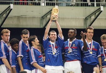 12 Jul 1998:  Joy for France as match winnner Zinedine Zidane lifts the trophy after victory in the World Cup Final against Brazil at the Stade de France in St Denis. Zidane scored twice as France won 3-0. \ Mandatory Credit: Ben Radford /Allsport
