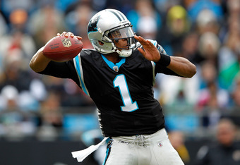 CHARLOTTE, NC - DECEMBER 24:  Cam Newton #1 of the Carolina Panthers drops back to pass during their game against the Tampa Bay Buccaneers at Bank of America Stadium on December 24, 2011 in Charlotte, North Carolina.  (Photo by Streeter Lecka/Getty Images