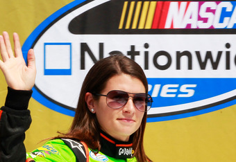 BROOKLYN, MI - JUNE 16:  Danica Patrick, driver of the #7 GoDaddy.com/Kickstartamerica.us Chevrolet, is introduced during pre-race cereemonies for the NASCAR Nationwide Series at Michigan International Speedway on June 16, 2012 in Brooklyn, Michigan.  (Ph