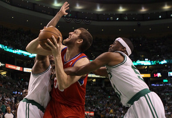BOSTON, MA - MAY 21: Spencer Hawes #00 of the Philadelphia 76ers tries to get past Paul Pierce #34 and Keyon Dooling #51 of the Boston Celtics in Game Five of the Eastern Conference Semifinals in the 2012 NBA Playoffs on May 21, 2012 at TD Garden in Bosto