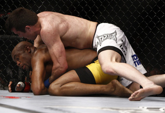 Anderson Silva could find himself in this position again if he comes out overaggressive (Anderson Silva and Chael Sonnen - Esther Lin/AOL)