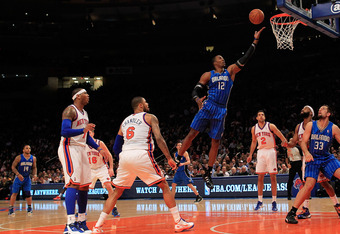 NEW YORK, NY - MARCH 28:  Dwight Howard #12 of the Orlando Magic lays the ball up agains the New York Knicks at Madison Square Garden on March 28, 2012 in New York City. NOTE TO USER: User expressly acknowledges and agrees that, by downloading and/or usin