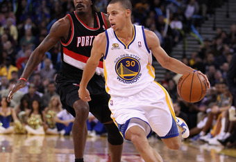 OAKLAND, CA - FEBRUARY 15:  Stephen Curry #30 of the Golden State Warriors in action against the Portland Trail Blazers at Oracle Arena on February 15, 2012 in Oakland, California. NOTE TO USER: User expressly acknowledges and agrees that, by downloading