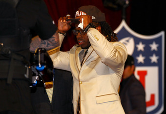 NEW YORK, NY - APRIL 26:  Trent Richardson from Alabama adjusts his hat as he walks on stage after he was selected #3 overall by the Cleveland Browns in the first round of the 2012 NFL Draft at Radio City Music Hall on April 26, 2012 in New York City.  (P