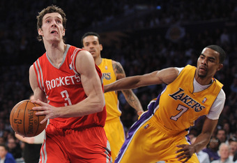 LOS ANGELES, CA - APRIL 06:  Goran Dragic #3 of the Houston Rockets heads to the basket past Ramon Sessions #7 of the Los Angeles Lakers during a 112-107 Rockets win at Staples Center on April 6, 2012 in Los Angeles, California.  NOTE TO USER: User expres
