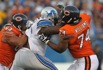 CHICAGO, IL - NOVEMBER 13: Roberto Garza #63 and Chris Williams #74 of the Chicago Bears try to block Corey Williams #99 of the Detroit Lions at Soldier Field on November 13, 2011 in Chicago, Illinois. The Bears defeated the Lions 37-13. (Photo by Jonatha