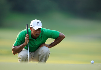 BETHESDA, MD - JUNE 30:  Tiger Woods lines up a putt on the 16th green during Round Three of the AT&T National at Congressional Country Club on June 30, 2012 in Bethesda, Maryland.  (Photo by Patrick McDermott/Getty Images)