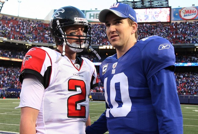 EAST RUTHERFORD, NJ - NOVEMBER 22:  Eli Manning #10 of the New York Giants talks with Matt Ryan #2 of the Atlanta Falcons after their game on November 22, 2009 at Giants Stadium in East Rutherford, New Jersey. The Giants defeated the Falcons 34-31 in overtime.  (Photo by Jim McIsaac/Getty Images)
